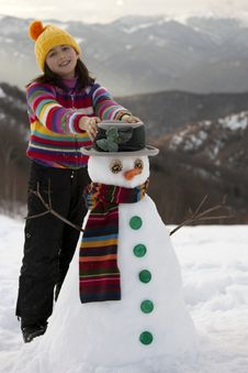 Free Girl Posing With Her Snowman Royalty Free Stock Image - 9021756