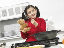 Little Girl In The Kitchen Stock Images