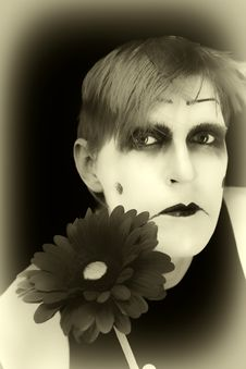 Free Gloomy Mime With  Red Flower Stock Photography - 9022172
