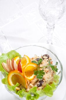 Goblet And Salad With Apples And Nuts Royalty Free Stock Photo