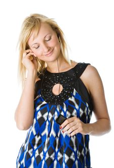 A Beautiful Young Girl Listening To Music Stock Image