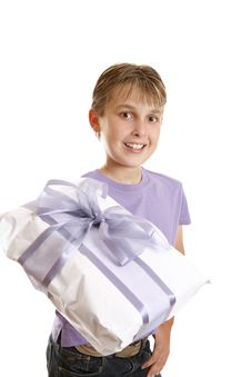 Free A Boy Holding A Wrapped Present Stock Photography - 9027162