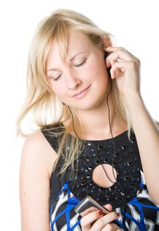 A Beautiful Young Girl Listening To Music Stock Photos