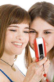 Free Two Pretty Girls Reading SMS On Mobile Phone Royalty Free Stock Photography - 9027757
