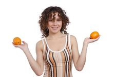 Woman With Oranges. Royalty Free Stock Images