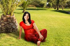 Free Pregnant Woman Sitting On The Grass Royalty Free Stock Photography - 9027987