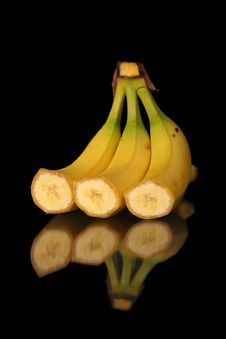 Mature Cut Bananas On Black Background Stock Images