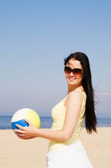Free Beautiful Woman Playing Volleyball At The Beach Stock Photography - 9028622