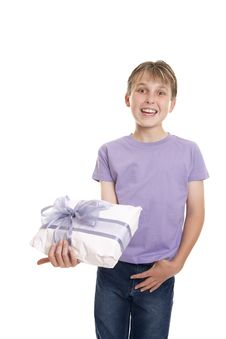 Free Smiling Boy Holds A Gift Wrapped Present Royalty Free Stock Photography - 9028777