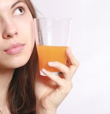 The Girl With A Glass Of Juice. Stock Photos
