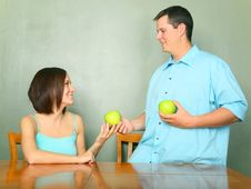 Free Male Caucasian Giving Green Apple To Young Woman Royalty Free Stock Photos - 9029228