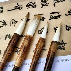 Free Art Brushes And Chinese Characters Royalty Free Stock Photo - 90279775
