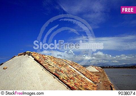 Sea Salt heaps covered terracotta, Trapani Stock Photo