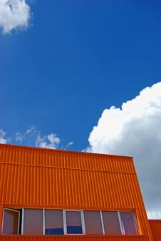 Free Orange Building With Cloudy Sky Stock Photos - 9034223
