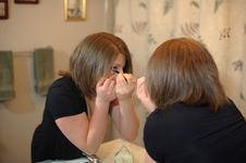 Free Putting On Makeup Stock Image - 9035611
