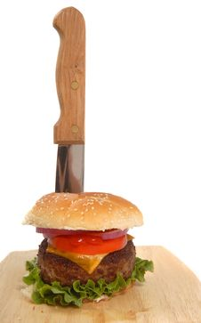 Free Cheeseburger With Knife In It Stock Photo - 9037310