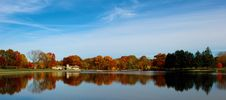 Free Lake Near Green Trees Under Blue And White Cloudy Sky During Daytime Royalty Free Stock Image - 90356116