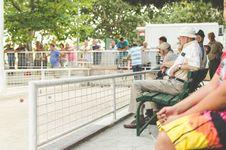 Free Group Of People Sitting On White Metal Mesh Balustrade Royalty Free Stock Photo - 90357015