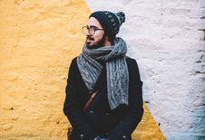 Free Man Wearing Scarf And Cap Stock Photo - 90357810