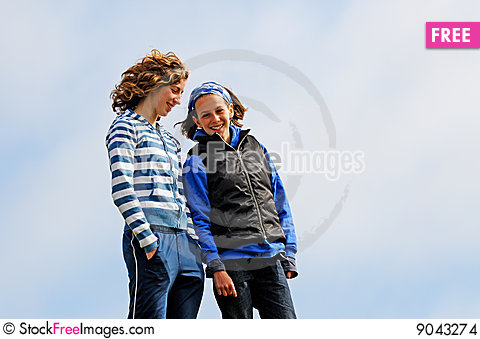 Teenage girlfriends chatting outdoors Stock Photo
