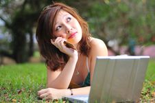 Free Asian Female Answering Telephone With Latop Stock Image - 9042001