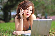 Free Pretty CHinese Girl Talking On Her Handphone Royalty Free Stock Image - 9042066