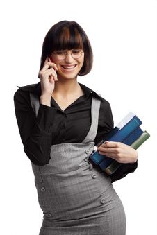 Smiled Brunette Schoolgirl Talking By Phone Stock Photography