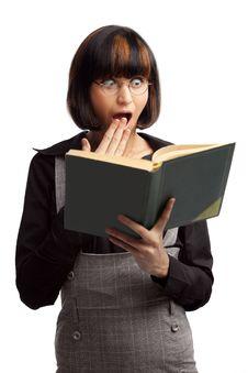 Surprised Brunette Schoolgirl Looking In The Book Royalty Free Stock Photos