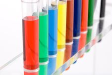Test Tube Colored On White Background Stock Photography