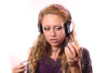 Free The Girl Admires With New Ear-phones Stock Photography - 9047712