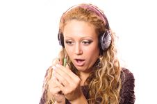 Free The Girl Admires With New Ear-phones Stock Photography - 9047742