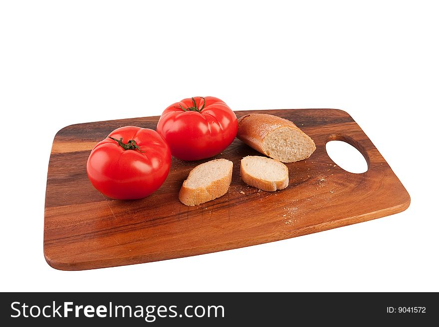 Two tomatoes and slices of baguette