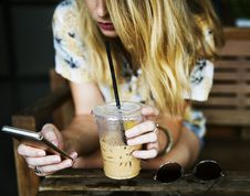 Free Woman Drinking Iced Coffee Stock Photography - 90429782