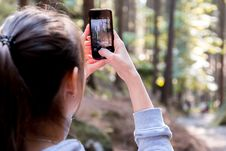 Free Woman Using Her Smartphone While Taking The Picture The Forest Royalty Free Stock Photography - 90489197