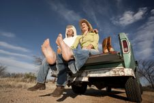 Free Cowboy And Woman On Pickup Truck Royalty Free Stock Photo - 9050405