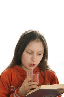 Free Reading Girl With Glass Of Juice Stock Image - 9050991