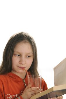 Free Reading Girl With Glass Of Juice Royalty Free Stock Photos - 9051008