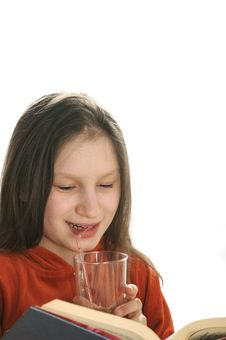 Free Reading Girl With Glass Of Juice Stock Photos - 9051023