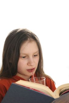 Free Reading Girl With Glass Of Juice Royalty Free Stock Image - 9051026