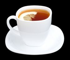 Free Cup Of Tea With Lemon And Saucer On Black Royalty Free Stock Image - 9051676