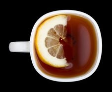 Cup Of Tea With Lemon On Black View From Above Royalty Free Stock Photography