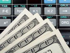 Dollars Over Calculator Stock Photos