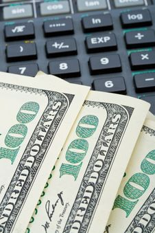 Many Dollars Over Calculator Royalty Free Stock Photography