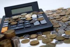 Free Coins & Calculator Royalty Free Stock Photos - 9053638
