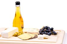 Free Cheese On The Hardboard Stock Image - 9054501