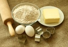 Flour, Oil, Eggs And Rolling Pin On Sacking Royalty Free Stock Image