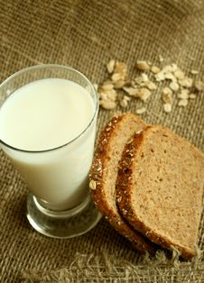 Free Glass Of Milk And Bread On A Sacking Stock Photos - 9056123