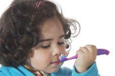Little Cute Girl Brushing The Teeth Royalty Free Stock Photos