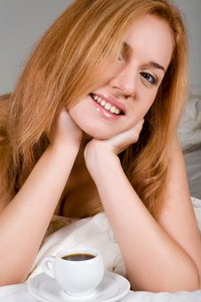 Lovely Woman Drinking Coffee In Bed Royalty Free Stock Images