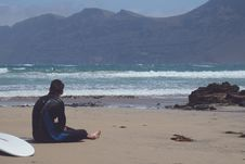 Free Man Sitting On Beach Sands Royalty Free Stock Images - 90553239